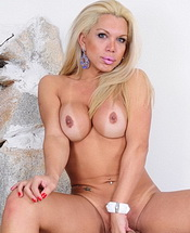 Mel stroking. Blonde shemale Mel showing her big cock and boobs