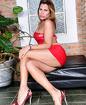 Viviane c posing in red. Hot tranny Viviane posing in libidinous red dress