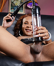 Chyna posing  naughty ebony ts chyna playing with a penis pump. Naughty ebony TS Chyna playing with a penis pump