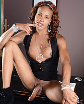 Chyna black dress. Ebony ladyboy Chyna posing her long hot tool
